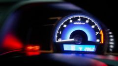 Close up of a speedometer in a car.