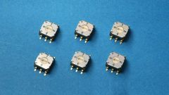 Six rotary switches on a blue background.