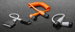 Three different cable assemblies on a grey background.