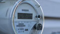 This image shows a smart electricity meter measuring energy consumption.