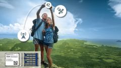 A hiking couple taking advantage of the Universal Mobile Telecommunications System (UMTS).