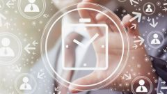 This image shows an abstract clock and a hand in the background pointing to it.