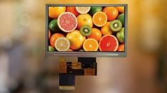 Thin-film transistor display with fruits on the screen.