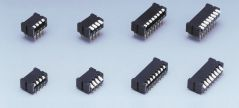 Eight DIP switches in different sizes on grey background.