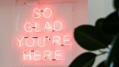 CODICO light sign that says: So glad you're here.